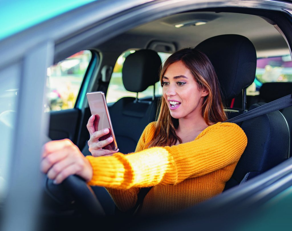 Woman distracted while driving